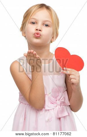 Little girl with red paper heart blowing kiss to camera