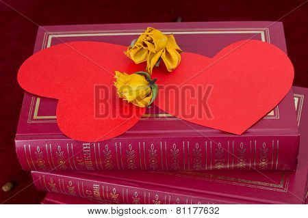 Two Red Hearts Lying With Dried Roses