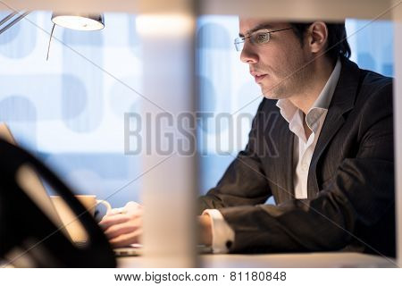 Businessman Sitting Working At His Desk