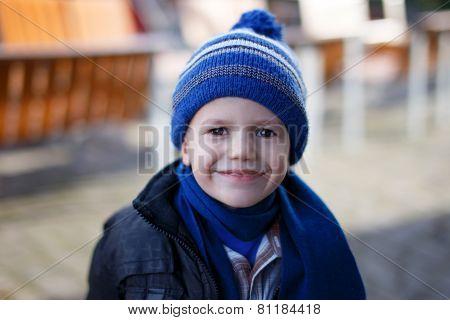 Little Boy In Winter Cap