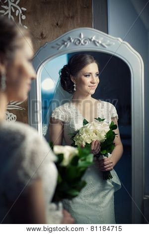Beautiful Bride With The Bouquet Near The Miror.