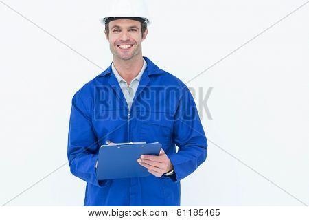 Portrait of confident supervisor writing notes over white background
