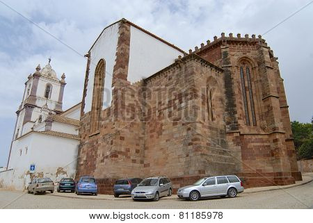 Cars parked outside of the Silves Cathedral in Silves, Portugal.