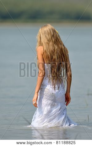 woman bride during photo session trash the dress