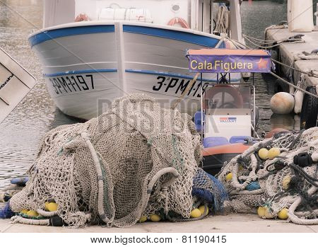 Cala Figuera Fishnets And Fishing Boat In Port