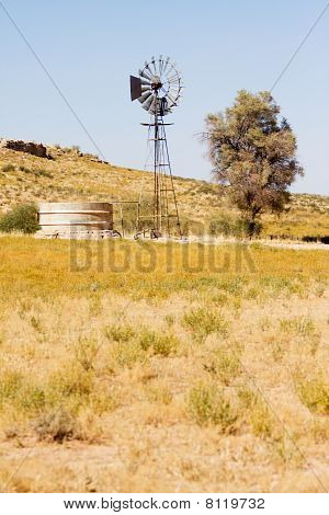 Windpump And Dam In The Kalahari Desert