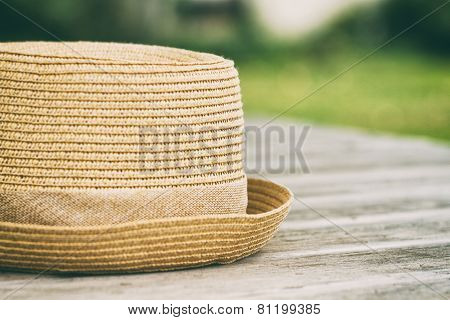 Hat on wooden table.