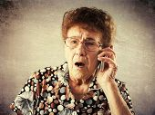pic of mature adult  - Surprised seniors talking mobile phone - JPG