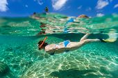 picture of caribbean  - Split photo of young woman snorkeling in turquoise ocean at Caribbean - JPG