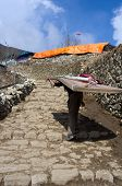 picture of porter  - Porter carry heavy load in Namche Bazar  Khumbu district - JPG