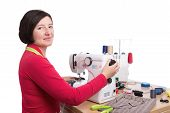 foto of sewing  - Woman seamstress at the sewing machine - JPG