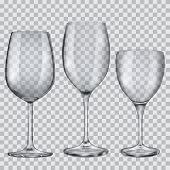 image of tumblers  - Three transparent empty glass goblets for wine - JPG