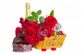 stock photo of casket  - Festive composition with red roses in a wicker basket bottle of champagne and a casket with jewelry isolated on a white background - JPG