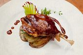 image of roast duck  - Duck pestle with potato and garlic - JPG
