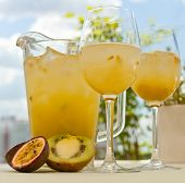 picture of pitcher  - Maracuya and kiwi lemonade pitcher with two glasses on the table - JPG