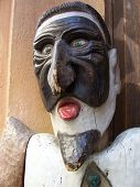 Wooden sculpture of the medieval actor in masquerade mask, old city, Prague, Czech Republic poster