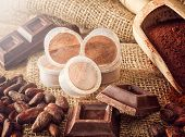 image of cocoa beans  - Capsules of chocolate with cocoa powder cocoa beans and pieces of chocolate. ** Note: Soft Focus at 100%, best at smaller sizes - JPG