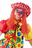 stock photo of clown face  - A colorful clown making a goofy cross - JPG