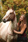 picture of appaloosa  - Amazing couple girl with appaloosa horse in autumn - JPG