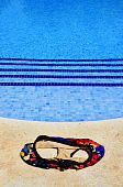 pic of nudism  - a swimsuit in a swimming pool in the summer - JPG