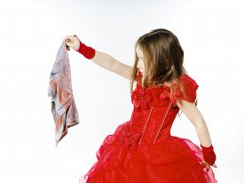 stock photo of cinderella  - Young cinderella dressed in red preparing to mop the floor by dirty cloth - JPG