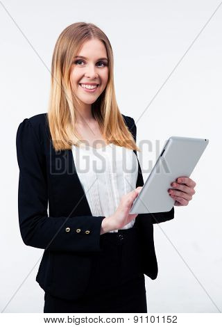 Smiling businesswoman using tablet computer isolated on a white background