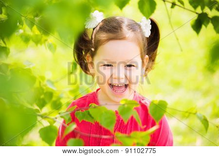 Closeup Portrait Of Funny Little Kid. Beautiful Girls Face Happy Laughing