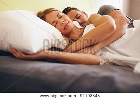 Young Couple Sleeping Embraced