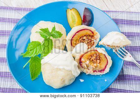 Sweet Plum Dumplings With Sweet Cream