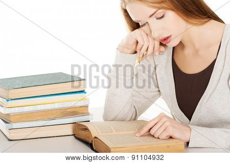 Tired woman preparing to exam.