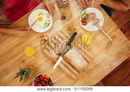 Morning Breakfast On Table With Couple Eating