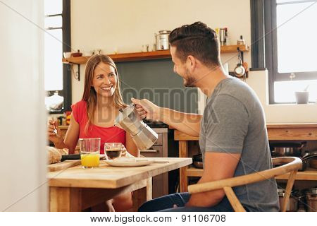 Couple Having Breakfast, Man Serving Coffee.