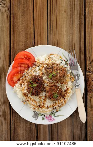 Three Lentil Patties With Rice And Tomato In White Plate Copyspace