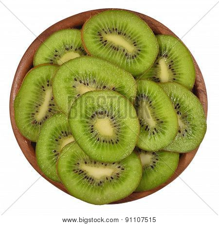 Sliced Kiwi Fruit In A Wooden Bowl On A White