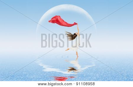 Young dancing girl on water surface