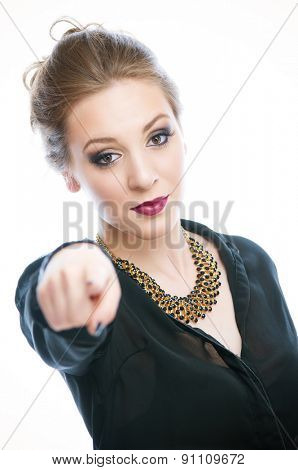 Attractive businesswoman pointing with her finger