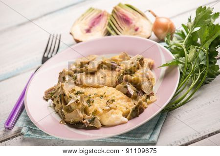 fillet fish with sauteed artichoke, selective focus