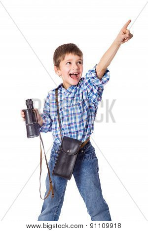Boy standing with spyglass and pointing