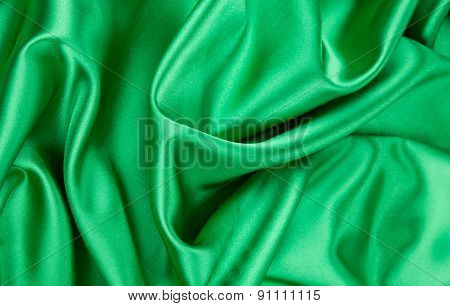 Green silk cloth with some soft folds.