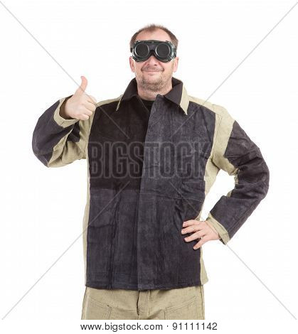 Welder in glasses with ok sign.