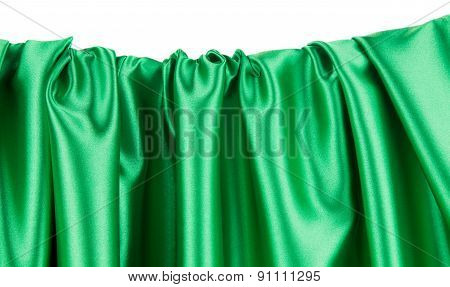 Green silk cloth with some folds.