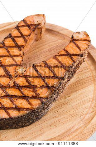 Grilled salmon steak on platter.