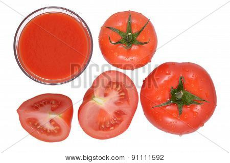 Tomato Juice And Tomatoes On A White