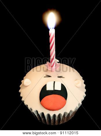 Crying Baby Cupcake With Birthday Candle On Black Background
