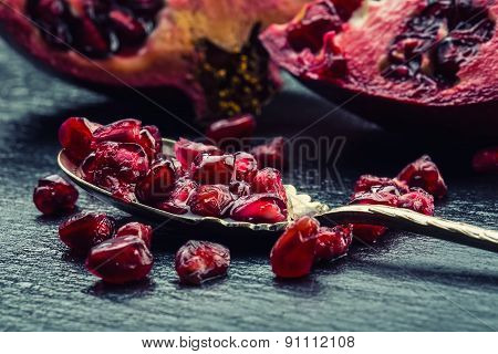 Pieces and grains of ripe pomegranate. Pomegranate seeds. Part of pomegranate fruit