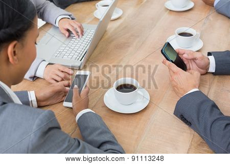 Business people in meeting with new technologies at the office