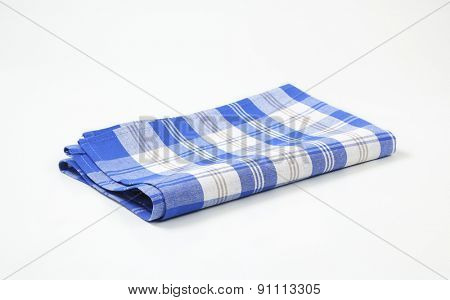 blue and white checkered dishtowel on white background