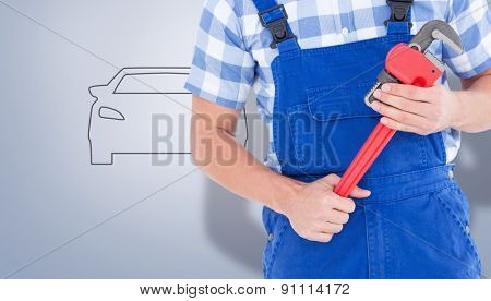 Repairman holding adjustable pliers against grey vignette