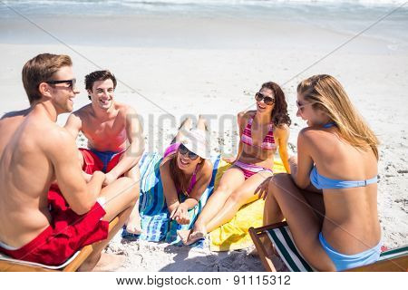 Happy friends sunbathing together at the beach