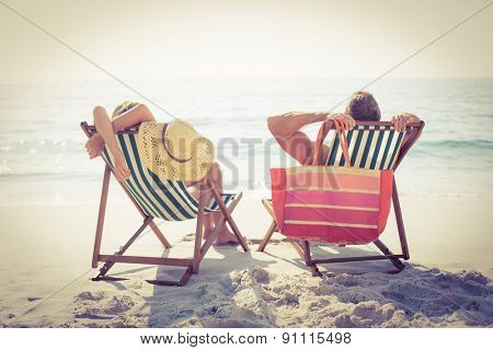 Couple relaxing on the beach on a sunny day